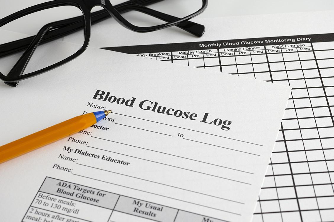 BLood Glucose log wrtitten on paper