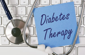 Diabetes therapy written on paper on computer keypad